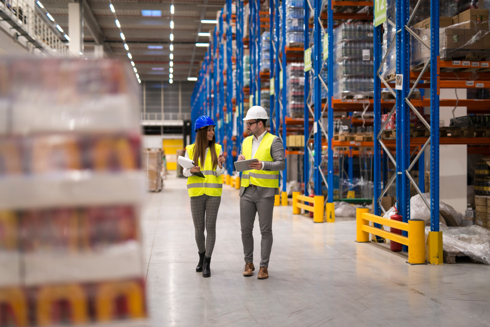 two associates walking through a warehouse of a shipping and logistics company