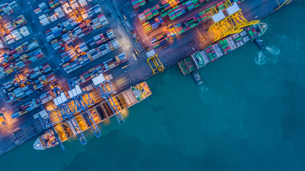aerial view of container ships at a port being loaded for ecommerce fulfillment companies