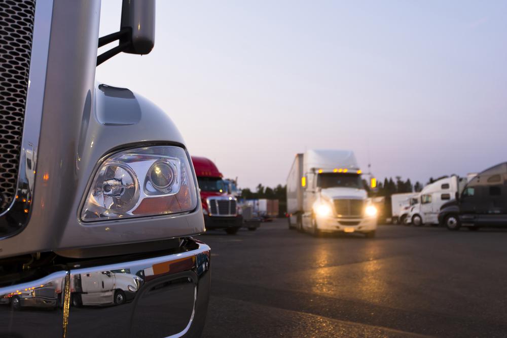several big rig trucks leaving a 3pl fulfillment center