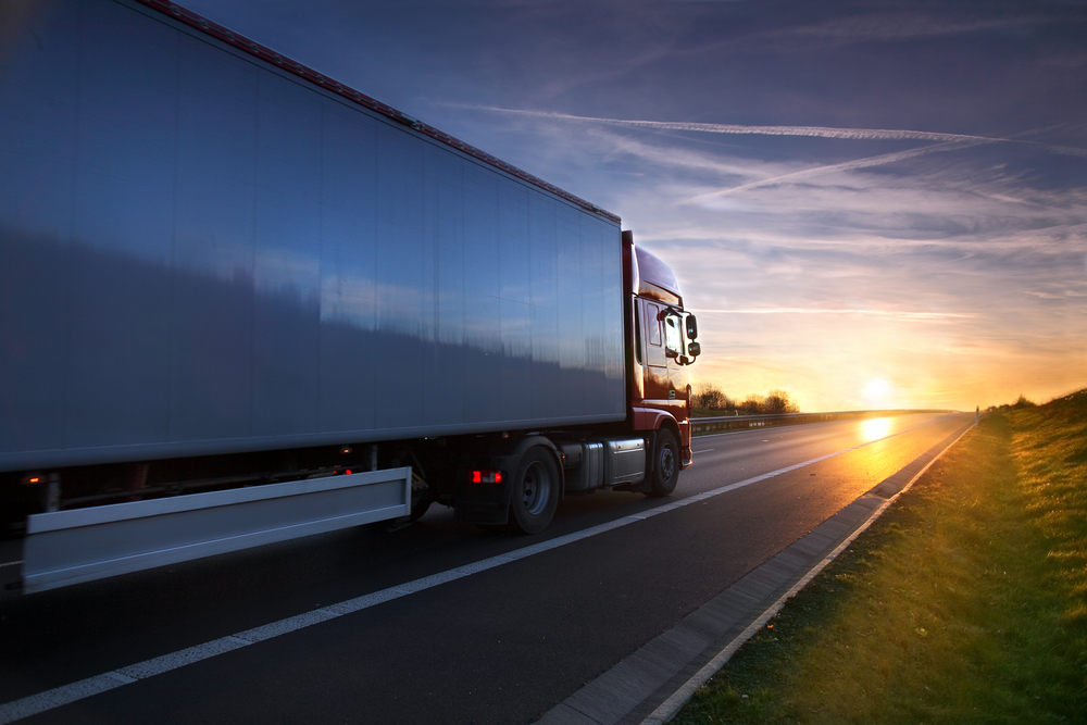 truck driving down highway for 3pl logistics and distribution